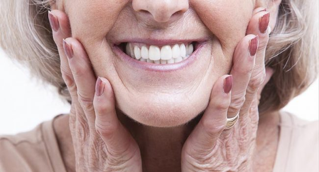 Woman smiling with white dentures